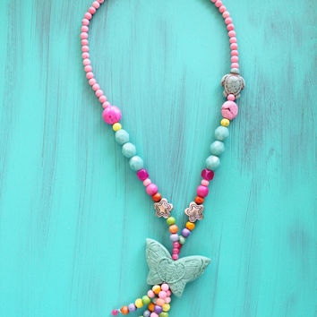 Girls bead tassel necklace, vintage butterfly pendant