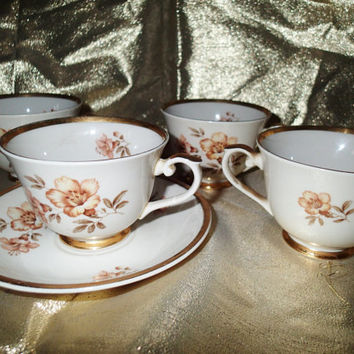 """China cup and saucer Arabia Finland """"Myrna""""  made in Finland, yellow hibiscus on white background with gold trim"""