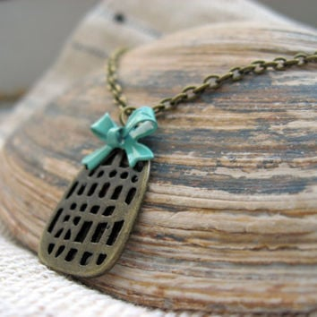 Bow and a Birdcage Necklace