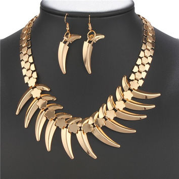 Gold Alloy Wolf Tooth Necklace and Earrings