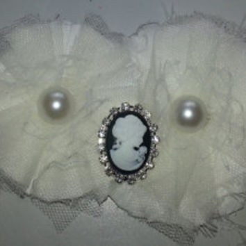 Handmade flower garter with pearl and cameo accents. One of a kind, can be customized to match your wedding colors!