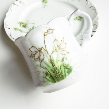 Vintage scallop-edge porcelain cup / teacup / tea cup / mug and dessert plate with gold flowers and green leaves