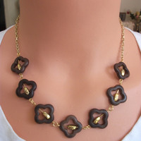 Brown marrocan open beads with gold etched spacers inserted.  This will definitely go with at least ONE of your tops!
