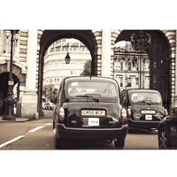 LONDON TAXIS FRAMED PRINT BY CINDY TAYLOR