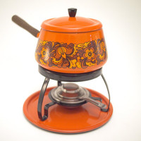 Orange fondu enamel ware pot / set with retro flower pattern, wooden handle, stand, burner and tray.