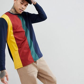 ASOS Relaxed Longline Long Sleeve T-Shirt With Vertical Colour Block In Navy at asos.com