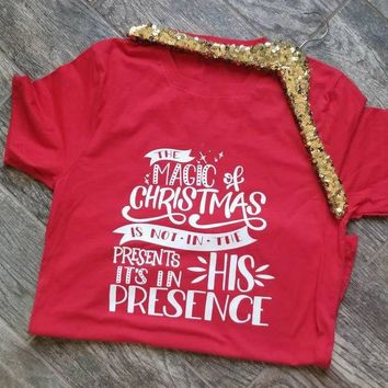 The Magic of Christmas is not in the Presents it's in His Presence Unisex slogan Holiday Shirt Graphic Tee Religious T-Shirt top