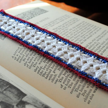 Crochet lace bookmark with white ribbon, red, white, and blue