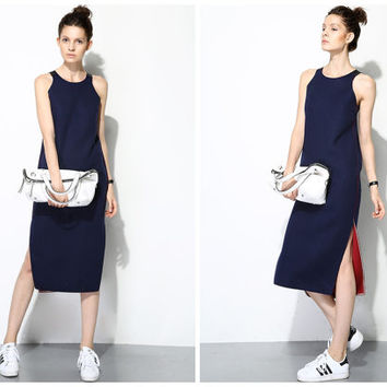 wool dress,winter dress,sleeveless,knee length,silt at side,leather stitching,zip at back,high fashion,minimalist,unique,chic,grunge.--E0416