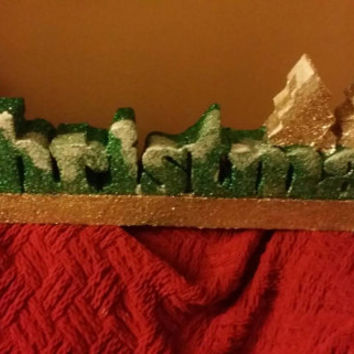 Holiday word Christmas mantel piece made of Styrofoam to celebrate