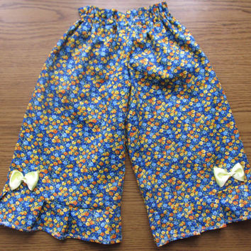 Ruffle toddler pants, Toddler pants, Floral ruffle baby pants,  Multicolored ruffle toddler pants with little flower detail.