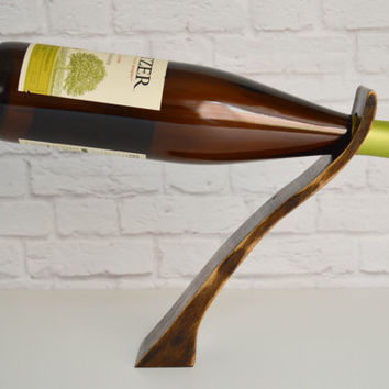Wave 73, an espresso mahogany wood gravity wine bottle holder, recycled wood wine display,