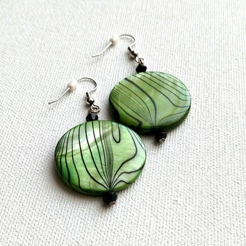 Green and black circular drop earrings.