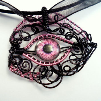 Eye Necklace wire wrapped Black and Pink.