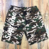 Supreme camouflage print letters casual men and women shorts Green