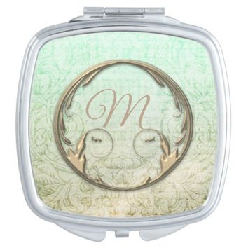 Victorian script and floral scroll mirror compact