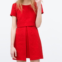 Asymmetrical skirt jacquard dress