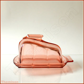 Pink pressed glass art deco butter dish, or cheese keeper, with lid. 1930s depression glass.