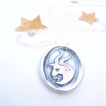 Capricorn zodiac wax seal pendant made from recycled fine silver