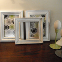 Shabby chic distressed picture frames -upcycled - 2 5x7 painted white with green, black and grey designs and 1 smaller empty white frame