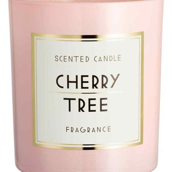 Scented candle in glass holder - Light pink/Cherry tree - Home All   H&M GB