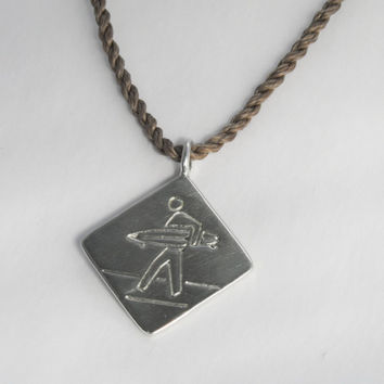 Surfer Crossing in sterling silver with cord