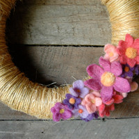 Sisal wreath with felt flowers. Vibrant floral wreath with bright pink and purple felt flowers. Great wreath for your front door decor.