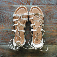 A Lace Up Sandal in Taupe