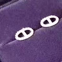 Hermes Tide brand nose shape logo earrings