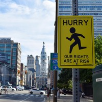 Hurry, Our Rights Are At Risk -- Street Sign