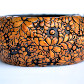 Gold and black bangle with floral pattern - polymer clay bracelet