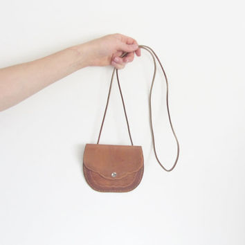 scallop edge leather purse . tiny chestnut saddle back pouch