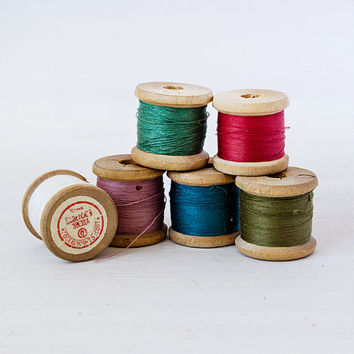 Set of six vintage wooden spools with threads of different colors, 1980s