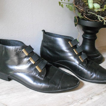 coolest Vintage black leather Ankle boots booties ... with brass .. indie hipster .. granny