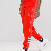 adidas Originals Authentic Tracksuit in Red at asos.com