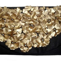 Upcycled coffee capsules flower clutch