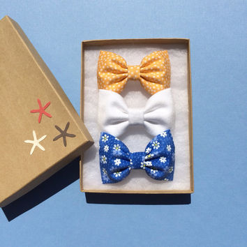 Yellow polka dot, white denim, and tiny blue daisy hair bow from Seaside Sparrow.  Perfect birthday gift for any girl.