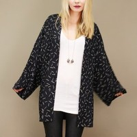Lightweight black vintage jacket with white confetti print throughout | shopcuffs.com