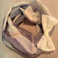 Nautical stipe infinity scarf with lace bow accent