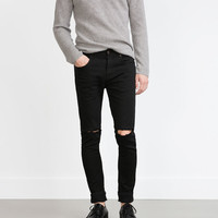 TROUSERS WITH KNEE RIPS