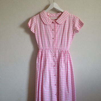 Vintage 1950s pink gingham shirt dress with peter pan collar.