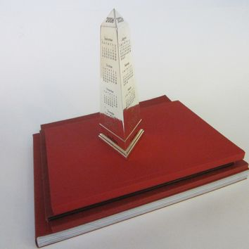 Obelisk Nickel Paperweight 2006 Calendar Neiman Marcus Exclusive