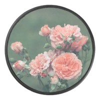 Beautiful pink roses on a natural green background hockey puck