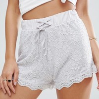 ASOS Scallop Lace Runner Shorts With Tie Waist at asos.com