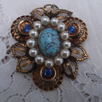 Gorgeous faux turquoise, pearl and gold tone brooch with 3 blue rhinestones. Ideal gift for , birthday, anniversary