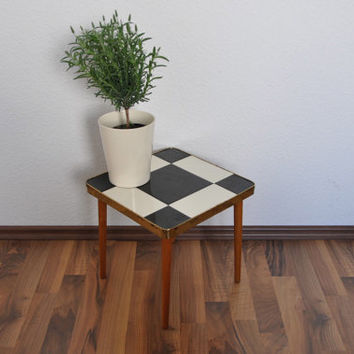 Small Mid Century Table. Black and cream ceramic tiles. Plant stand. Germany. 1960s.