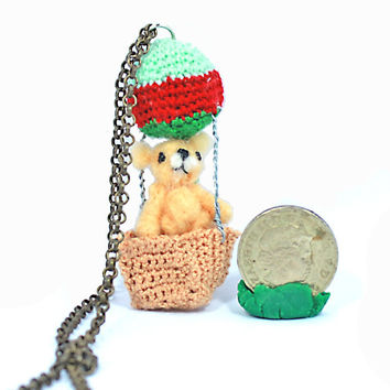 brown miniature needle felted bear with crocheted ballon on a handmade pendent charm and brass chain necklace