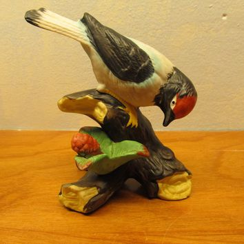 two vintage porcelain red headed bird figurines