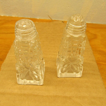 VINTAGE PRESSED GLASS SALT AND PEPPER SHAKERS WITH GLASS LIDS