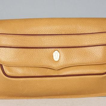 Vintage Cartier leather in yellow mustard color clutch with gold tone charm. must de C